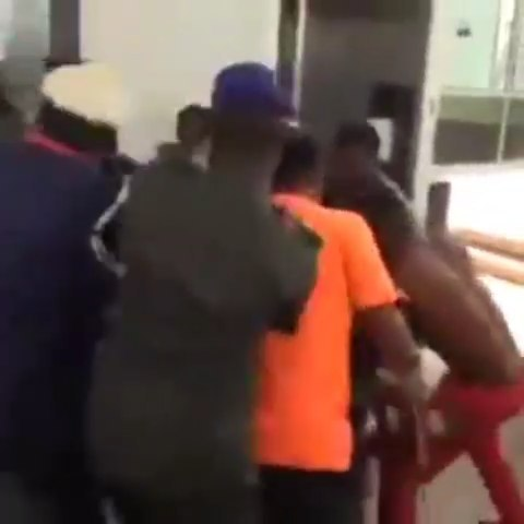 Angry persons living with disability beat up security officer at the National Assembly Abuja.  The persons  living with disabilities from the Niger Delta region  stormed the National Assembly Complex in Abuja to protest neglect by Federal Lawmakers representing them in the Federal Legislature.  They fought with the security officers who stormed them from gaining entrance to the complex