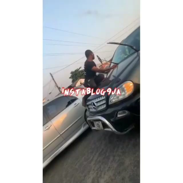 Spider-Man climbs the bonnet of a Benz that nearly hit him in Okota, Lagos State