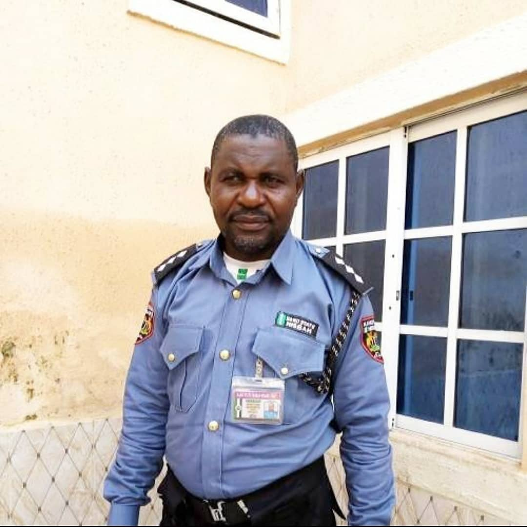 Identity of Kano Hisbah Commander allegedly caught in hotel room with married woman is revealed.  His name is Sani Rimo, a senior official with the Kano State Hisbah Board.  He is said to be in charge of arresting beggars and prostitutes in Kano metro area.   He was taken into custody after the husband of the woman with whom he allegedly had affairs filed complaints.  The Kano State Hisbah Corps is a religious police force in Nigeria's Kano state responsible for the enforcement of Sharia.  Hisbah officers regularly arrest unmarried people caught in hotels and people breaking Sharia laws. They also punish those who are indecently dressed, have haircuts considered immoral in Islam, and they are known to destroy crates of alcohol.