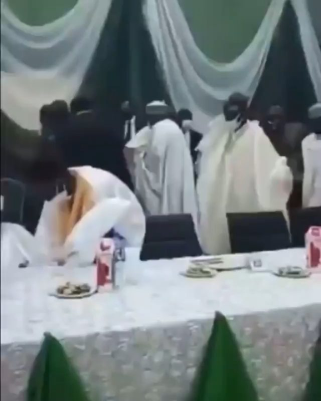 Watch moment APC National leader, Bola Tinubu, almost fell after missing his step at the 11th edition of the annual Arewa House lecture series in Kaduna today March 27.