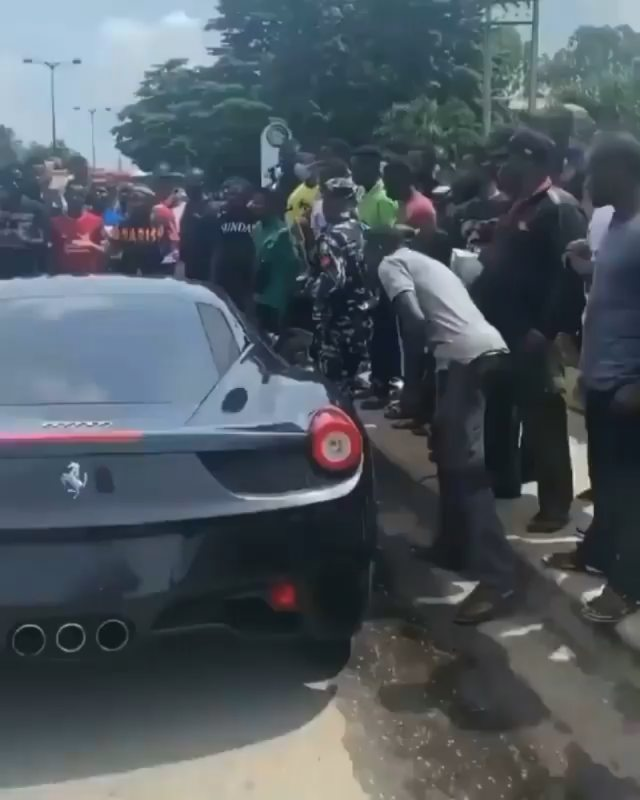 Burna Boy get cars sha... Ah ah! Yesterday na Rolls Royce, today Na Ferrari. See flexing.